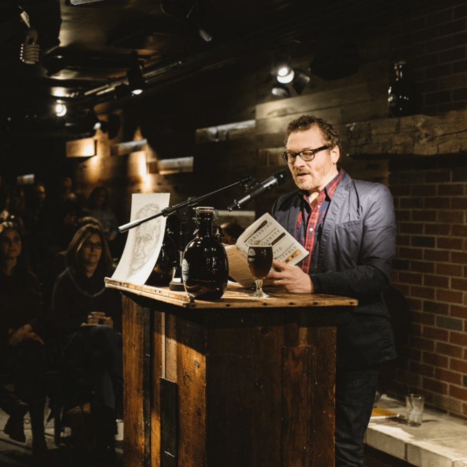 David Giffels reading at a podium