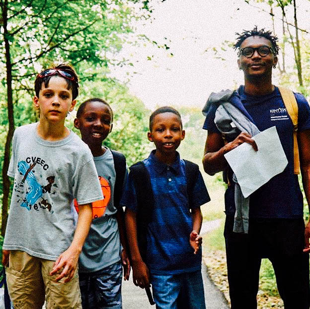 Image of Isaiah with three young poets on a hike