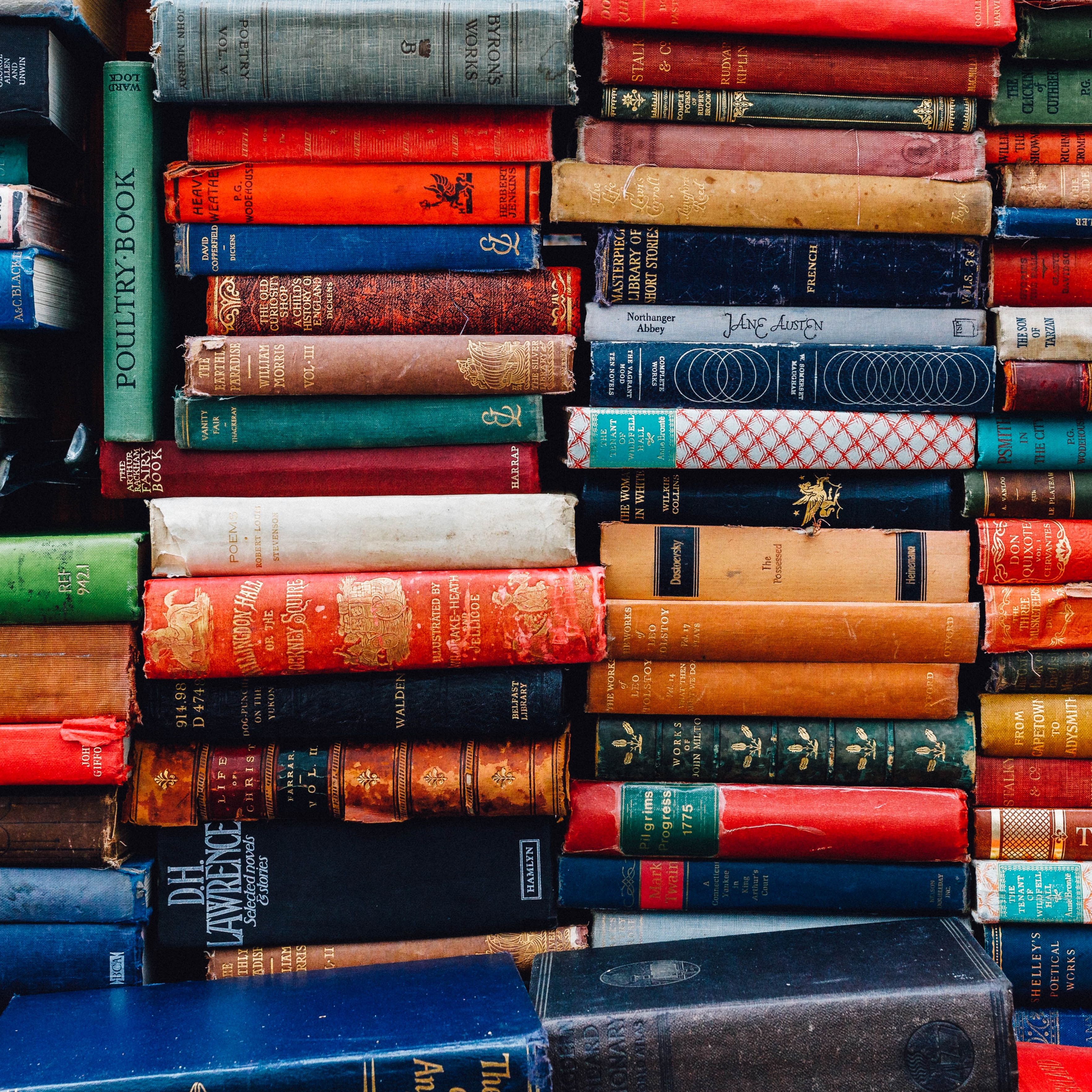 Image of books stacked on top of one another